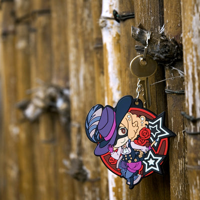 Persona 5 - Noir Keychain hanging on a fence