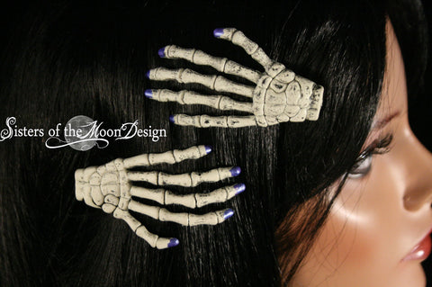 Skeleton hands hair clips with painted matallic blue nails pair