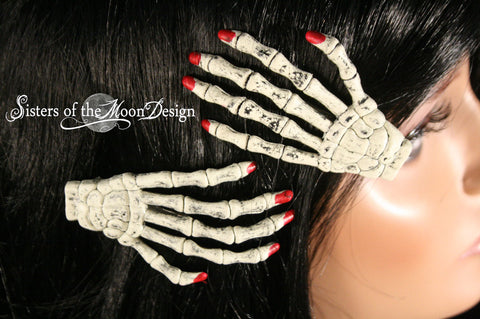 Skeleton hands hair clips with painted red nails pair