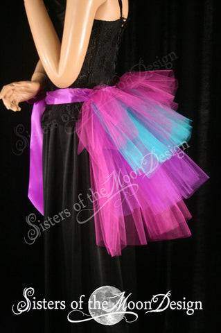 Beautiful burlesque tie on Bustle in fuchsia teal purple and pInk