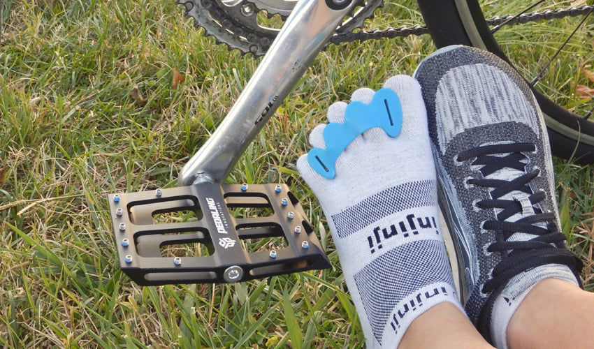 A combination of natural footgear, including Catalyst Pedals, Correct Toes, Injinji toe socks, and foot-shaped athletic shoes