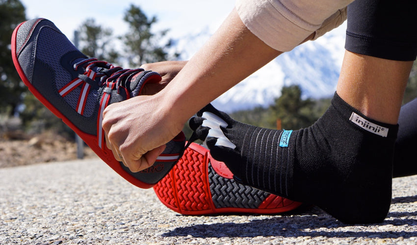 A runner pairing Correct Toes with Xero Prio shoes, Strutz Pro foot pads, and Injinji toe socks
