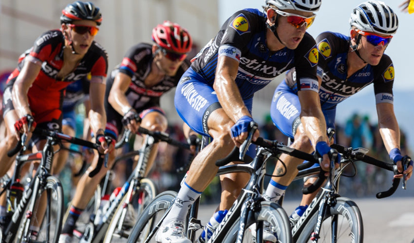 Professional road cyclists competing against one another in a race