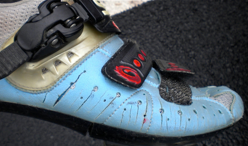 Side view of a road cycling shoe that has been modified using cycling shoe surgery techniques