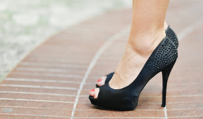 A woman in high heels, which tend to have the most heel elevation of any type of footwear