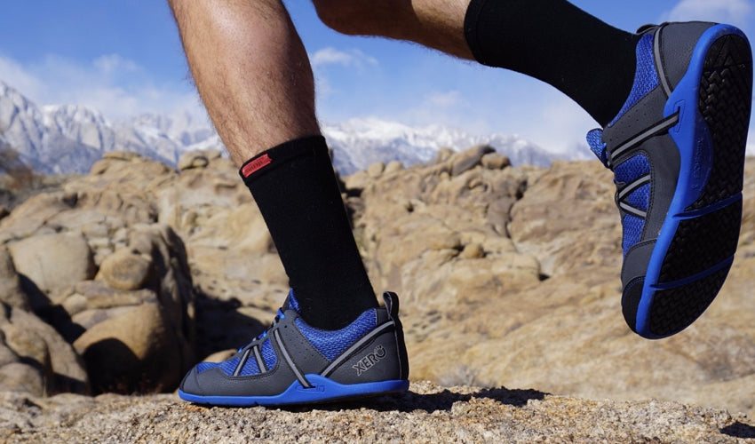 A trail runner wearing Xero Prio athletic shoes