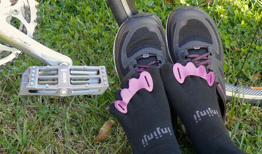 Cyclist using Catalyst Pedals while wearing Correct Toes toe spacers and Injinji toe socks