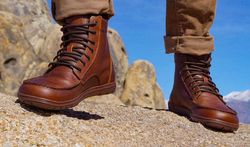 Lems Boulder Boot in Leather Russet with mountains in background