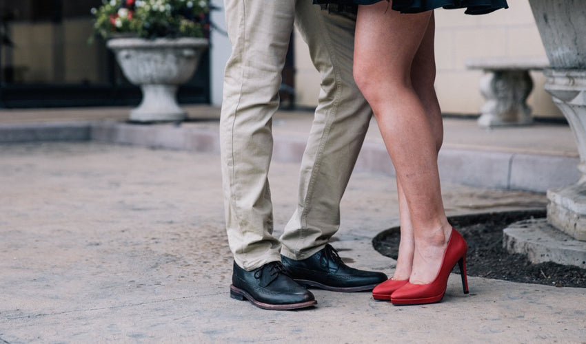 Couple being romantic while wearing injurious dress footwear