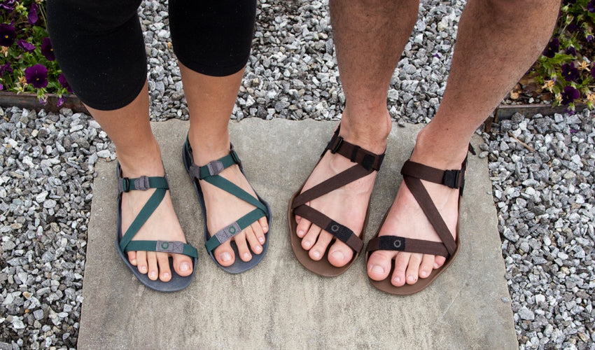 A top-down view of Xero Z-Trek athletic sandals worn by a man and a woman