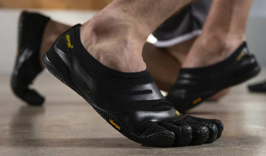 A wrestler wearing Vibram FiveFingers toe shoes