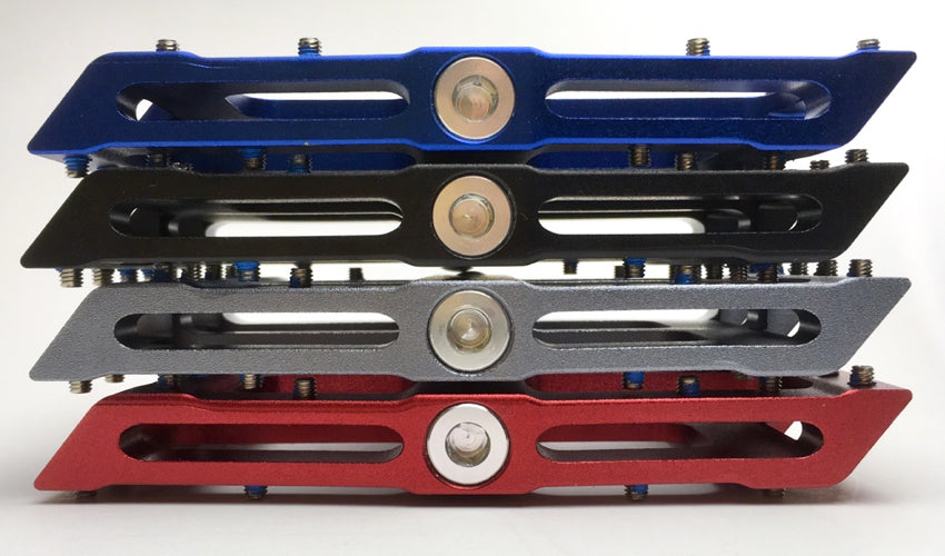 A close-up view of a stack of four Catalyst Pedals