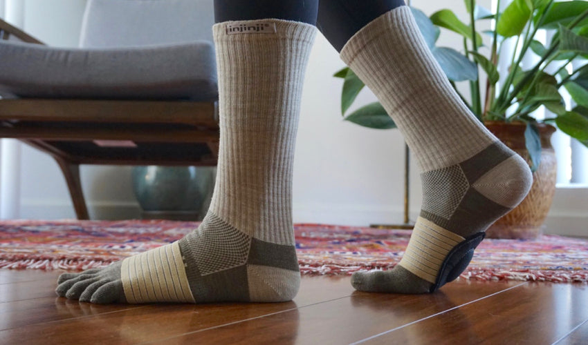 Side view of a pair of feet in Strutz foot pads and Injinji toe socks