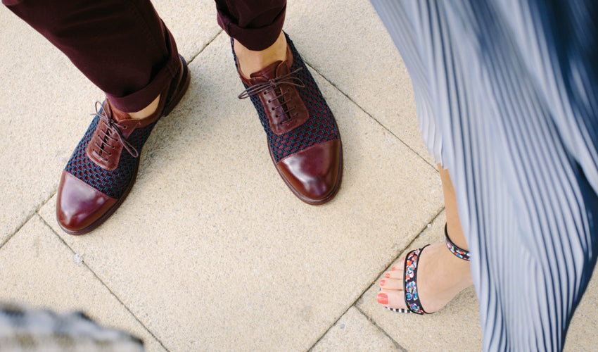 Top-down view of men's and women's dress footwear that incorporates tapering toe boxes