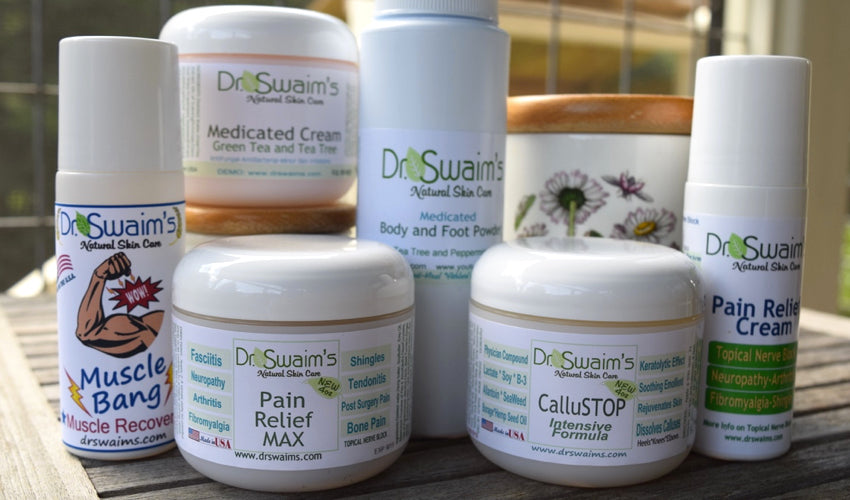 A collection of Dr. Swaim's foot care products sitting on an outdoor table