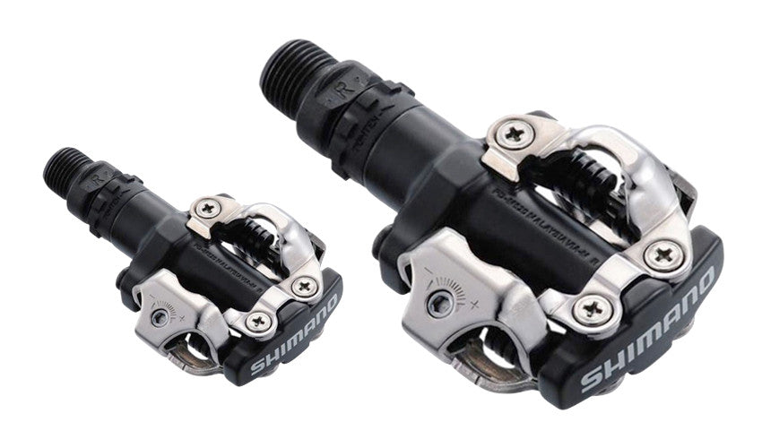 A close-up view of a pair of Shimano clipless pedals