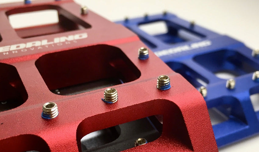 Close up view of several traction pins on the Red Catalyst Pedal
