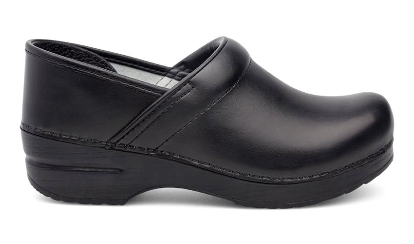 Close up image of a single black leather clog against a white background