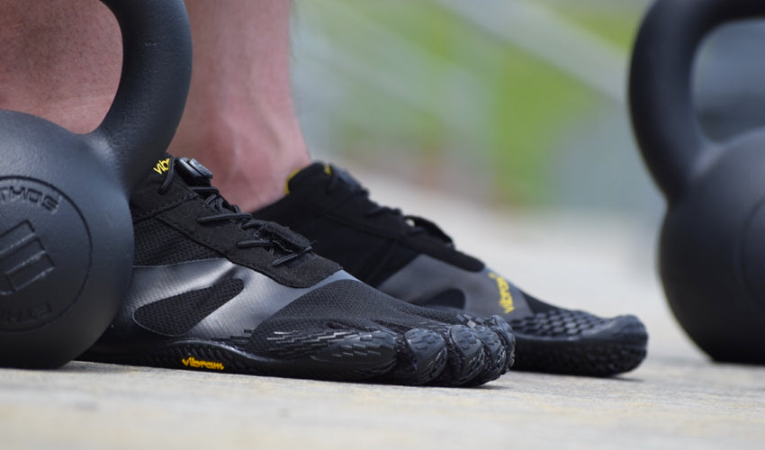 Close-up view of a pair of Vibram FiveFingers KSO EVO shoes and kettlebell