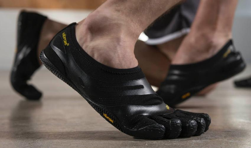 The feet of a wrestler wearing a pair of Vibram FiveFingers toe shoes