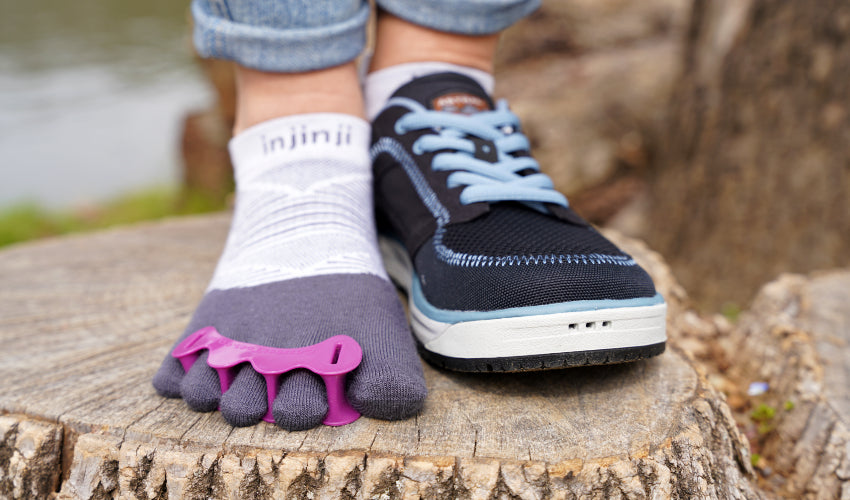 Person donning a pair of Correct Toes Original toe spacers