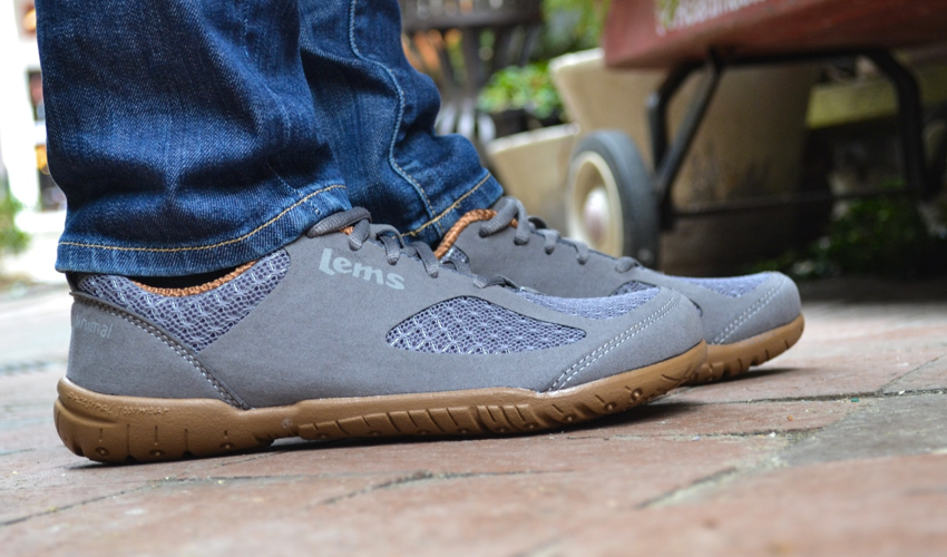 A close-up side view of a pair of Lems Primal 2 Slate shoes