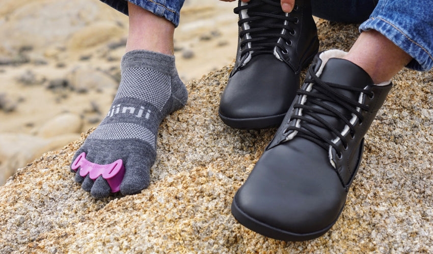 A hiker sporting a pair of Correct Toes Plum toe spacers as well as other natural footgear