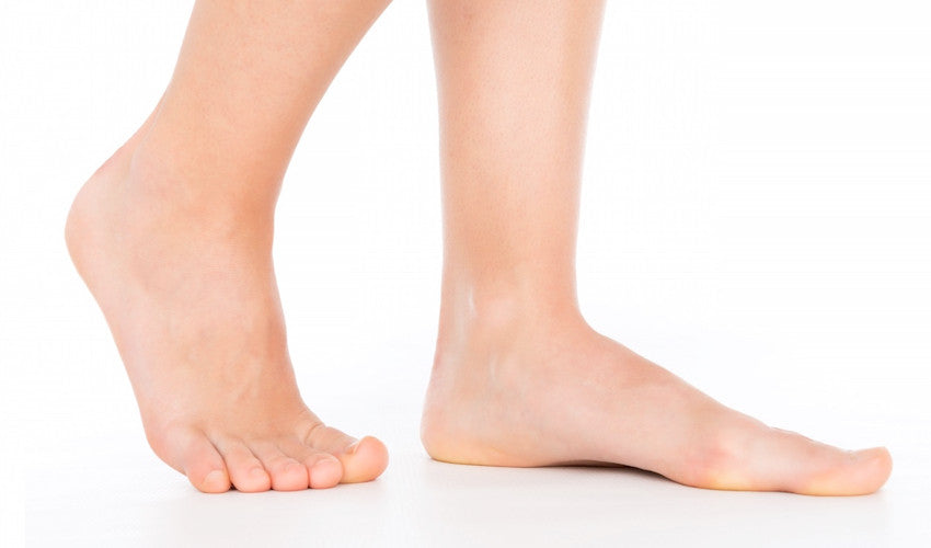 A pair of bare feet showing the medial longitudinal arch