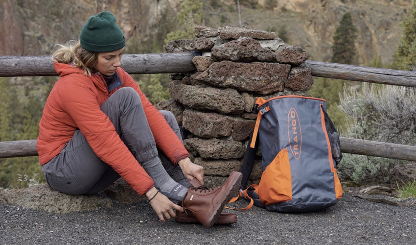 Female hiker donning Lems Boulder Boots in Leather Russet in cold weather conditions