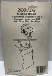 TAS011315 - 1958 The Peanuts Snoopy Christmas Stocking Hanger