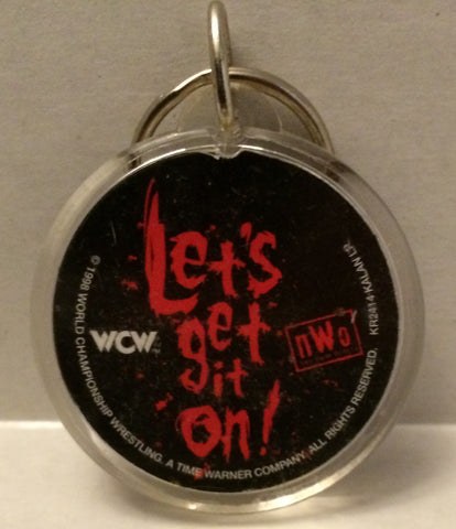 "(TAS003120) - WWF WWE WCW Wrestling Circle Keychain - ""Let's Get It On!"", , Keychain, WWE, The Angry Spider Vintage Toys & Collectibles Store  - 1"