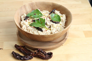 "Raw Creamy Cauliflower ""Rice"" Risotto with Sun-Dried Tomatoes"