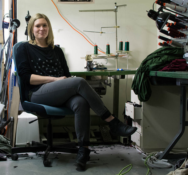 Beth Ardron sitting at sewing machine Poison Pear About