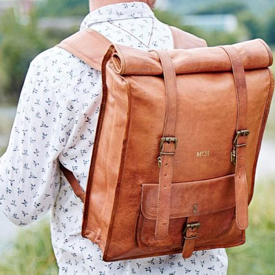 Leather rolltop rucksack pictured on person