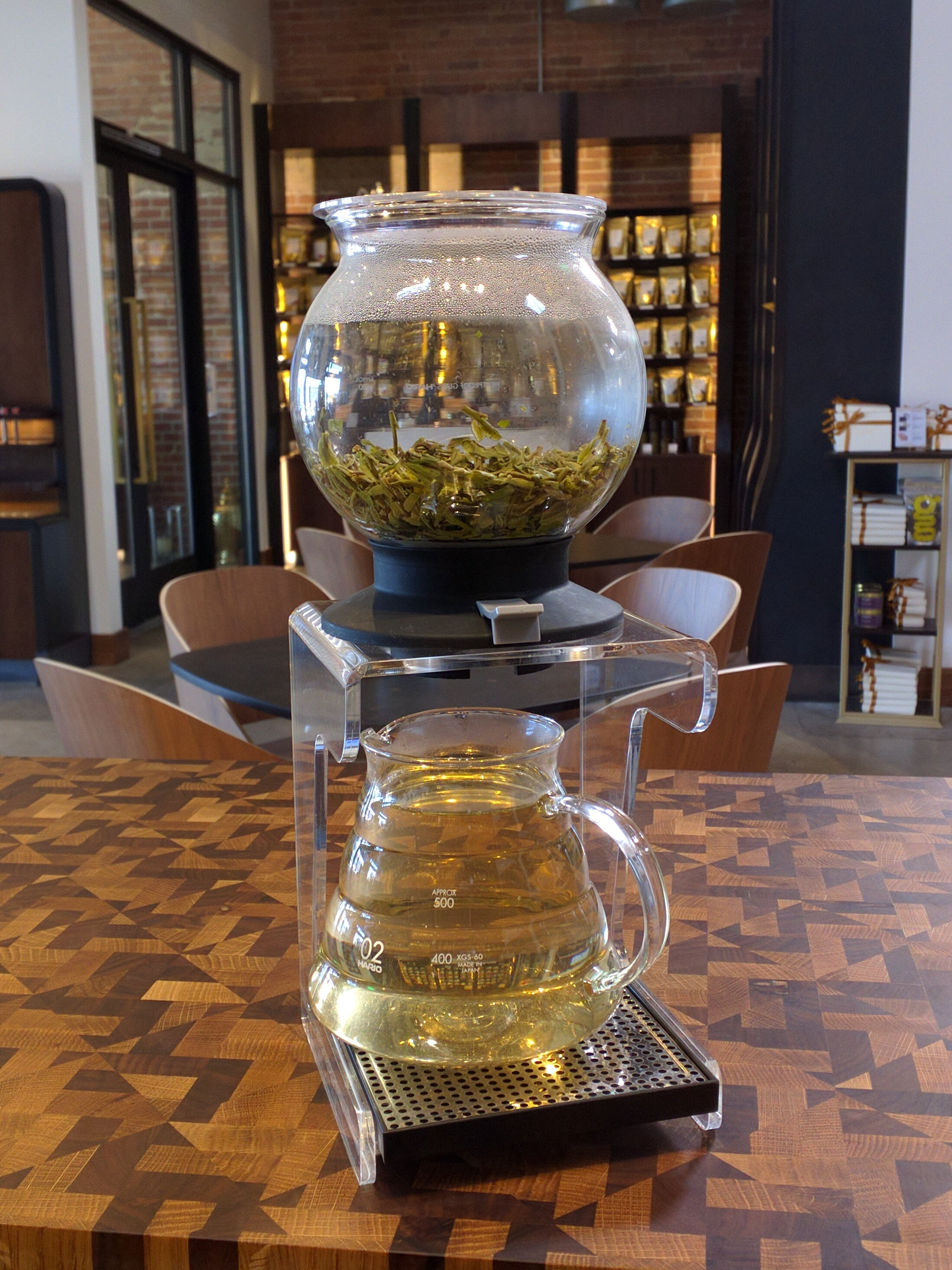 long jing green tea in a hario globe