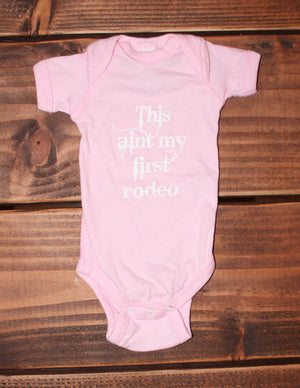 Z This Ain't My First Rodeo Pink Onesie