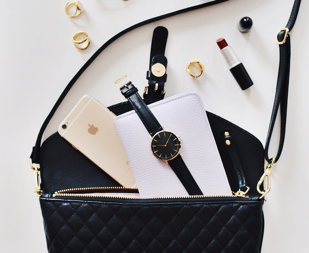 9 Products Every Woman Needs To Have In Her Purse Year Round