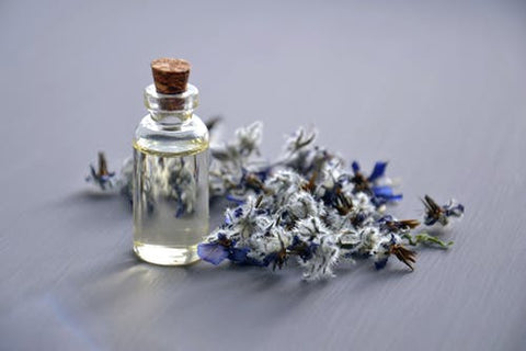 Bottle with clear liquid and flowers