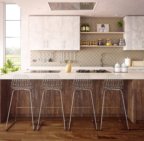 Clean white and brown kitchen with metal kitchen stools.
