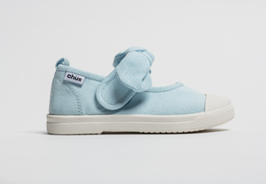 Canvas sneakers with single velcro strap and removable bow tie in light blue. Adorable monogrammed. Chus Shoes. Side view.