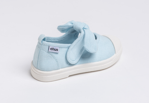 Canvas sneakers with single velcro strap and removable bow tie in light blue. Adorable monogrammed. Chus Shoes. Back view.