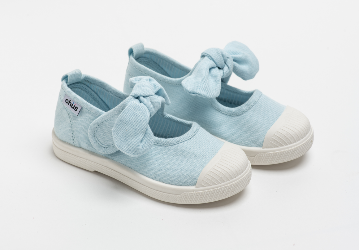 Canvas sneakers with single velcro strap and removable bow tie in light blue. Adorable monogrammed. Chus Shoes.