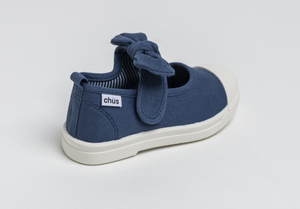 Canvas sneakers with single velcro strap and removable bow tie in navy blue. Adorable monogrammed. Chus Shoes. Back view.