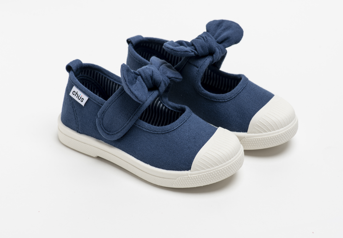 Canvas sneakers with single velcro strap and removable bow tie in navy blue. Adorable monogrammed. Chus Shoes.