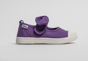 Canvas sneakers with single velcro strap and removable bow tie in purple. Adorable monogrammed. Chus Shoes. Side view.
