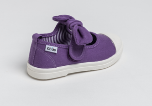 Canvas sneakers with single velcro strap and removable bow tie in purple. Adorable monogrammed. Chus Shoes. Back view.