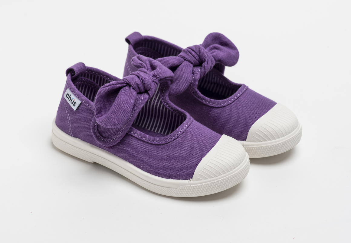 Canvas sneakers with single velcro strap and removable bow tie in purple. Adorable monogrammed. Chus Shoes.