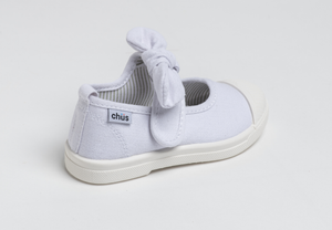 Canvas sneakers with single velcro strap and removable bow tie in white. Adorable monogrammed. Chus Shoes. Back view.