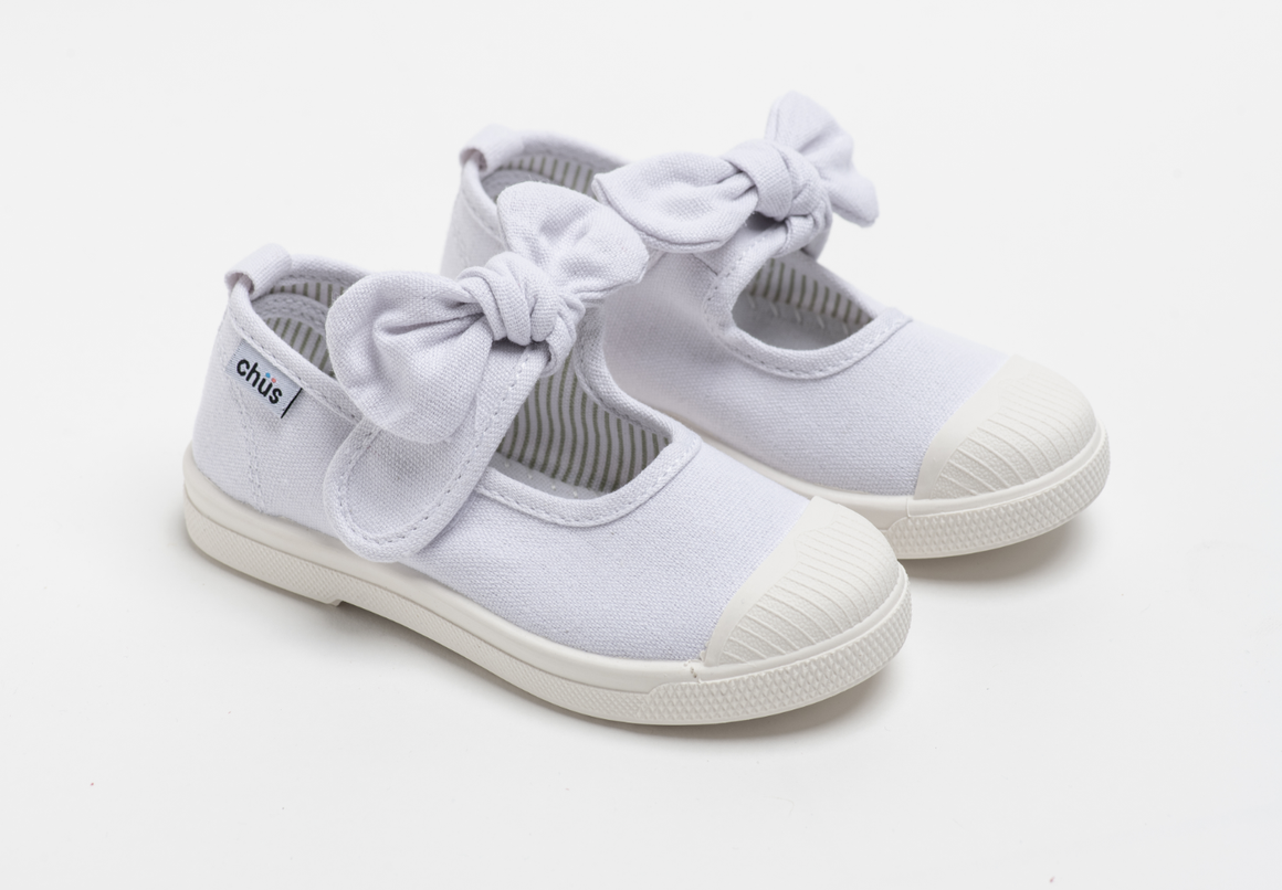 Canvas sneakers with single velcro strap and removable bow tie in white. Adorable monogrammed. Chus Shoes.