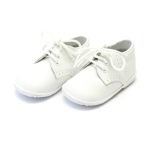 white leather baby boy's lace-up boot from L'Amour Shoes available at Threadfare